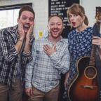 Alex Goldschmidt and fiance Ross Girard pose with Taylor Swift.