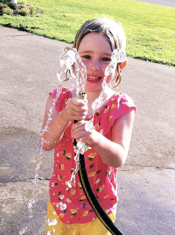 PHOTO: Sylvie plays with water from a hose in this undated family photo.