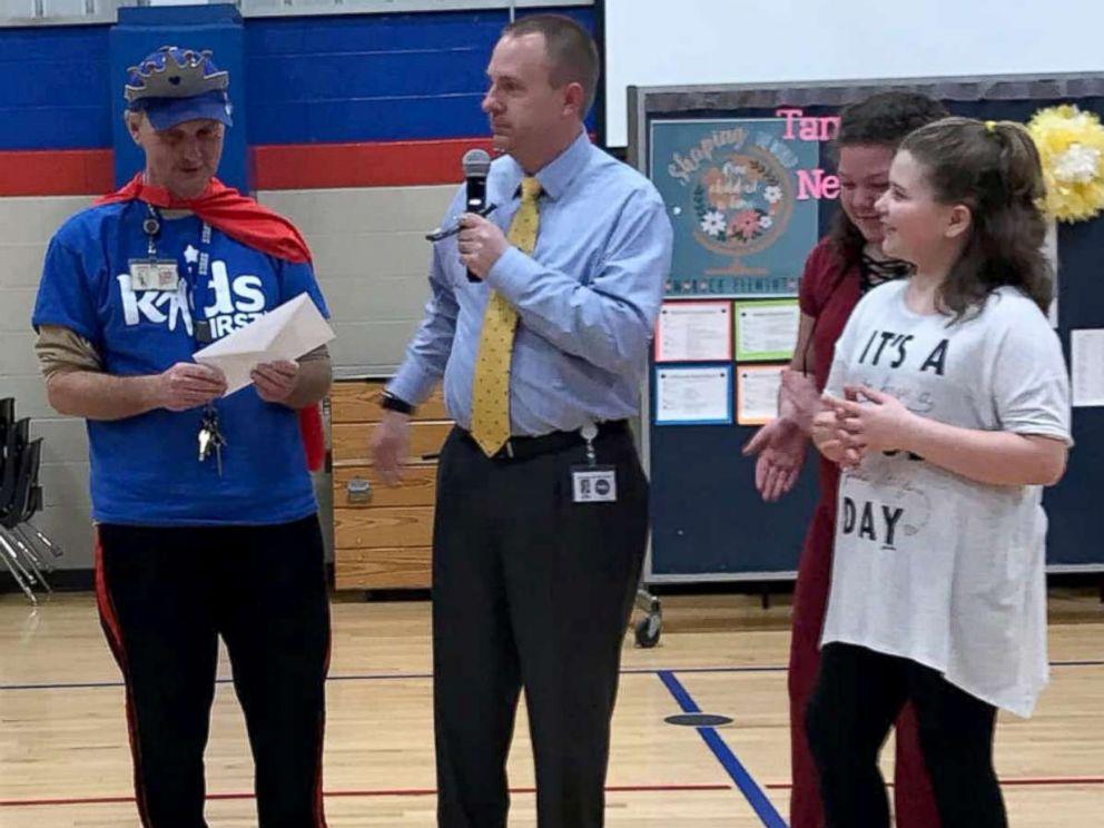 PHOTO: From left, Tamarack Elementary School head custodian Ricky Young poses with Superintendent Matt Robbins, Layliana Calmese and Addilyn Simpson.