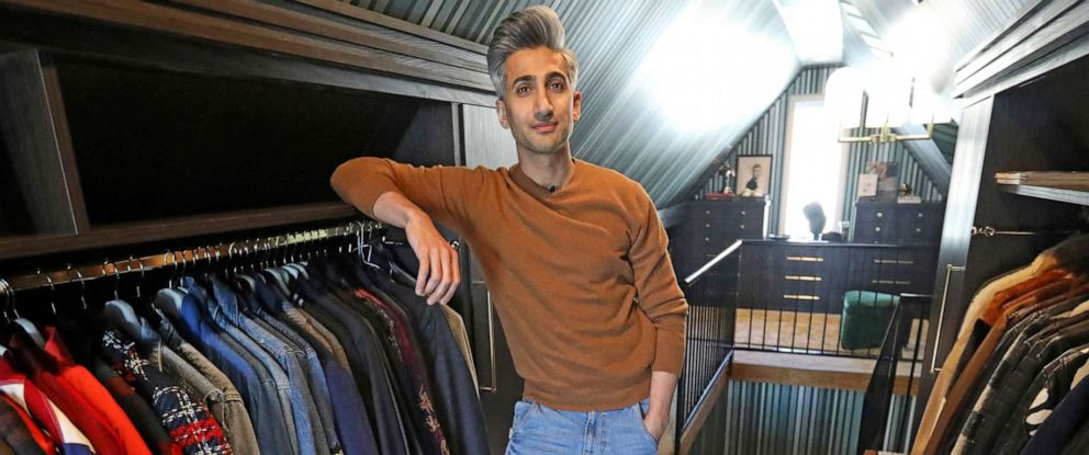 """PHOTO: Tan France, a cast member on the Netflix series """"Queer Eye,"""" poses among his clothes in the attic of his home in Salt Lake City."""