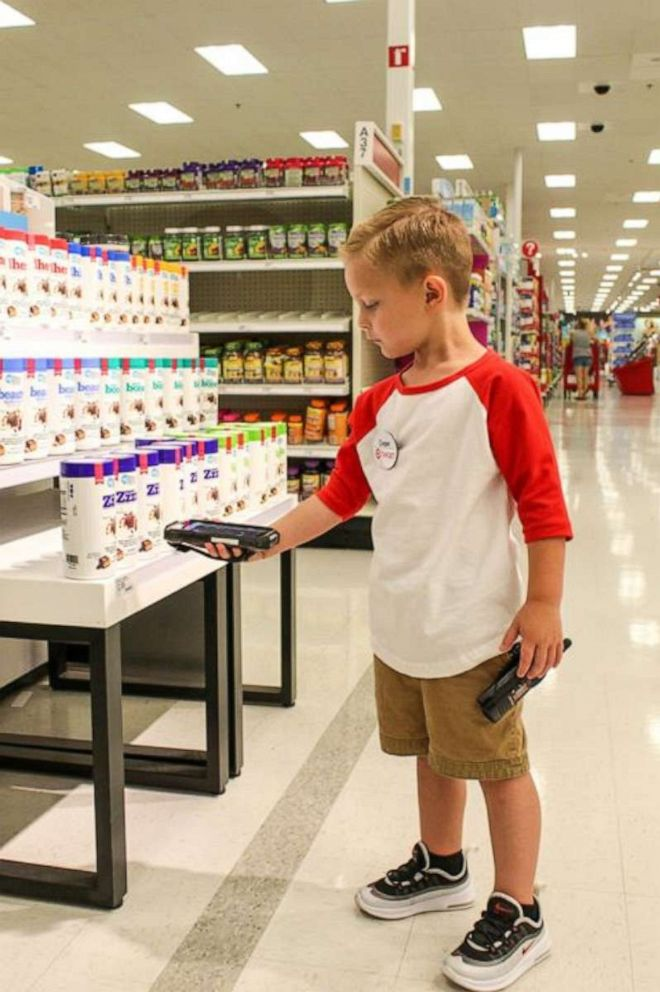 PHOTO: Coopers duties as a Target employee for the day included scanning merchandise on the shelves.