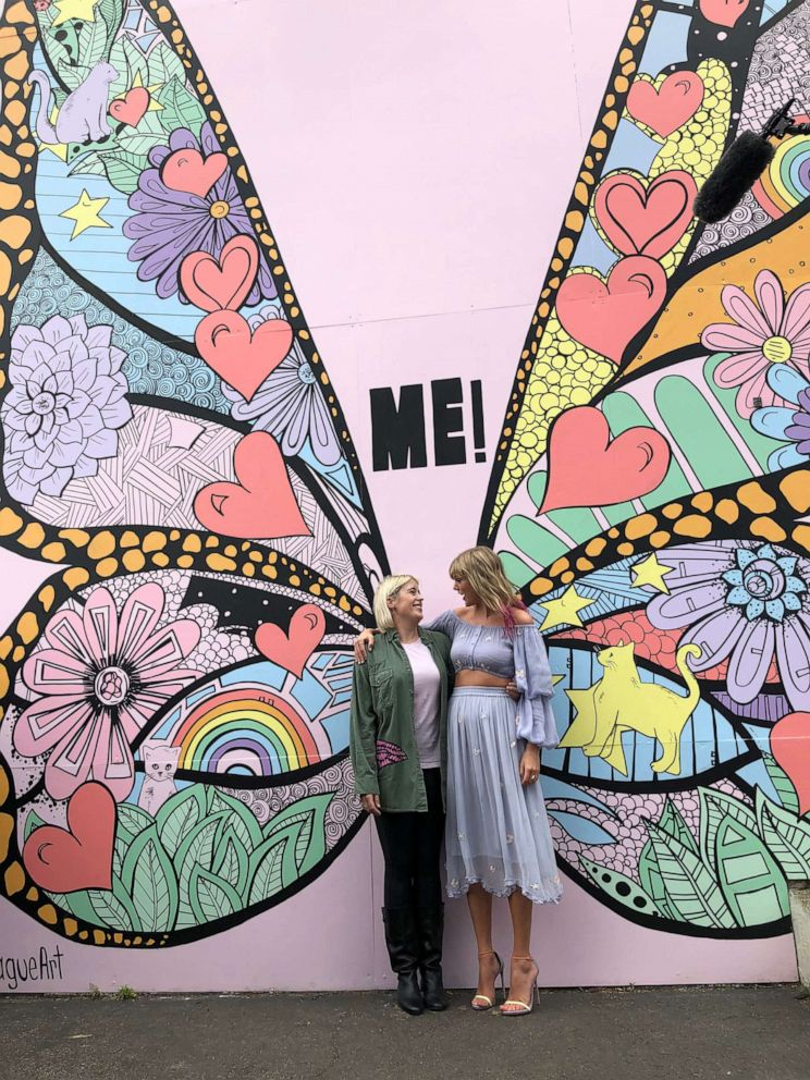 PHOTO: Taylor Swift poses with artist Kelsey Montague in front of her new mural, What Lifts You Up, in Nashville, April 25, 2019.