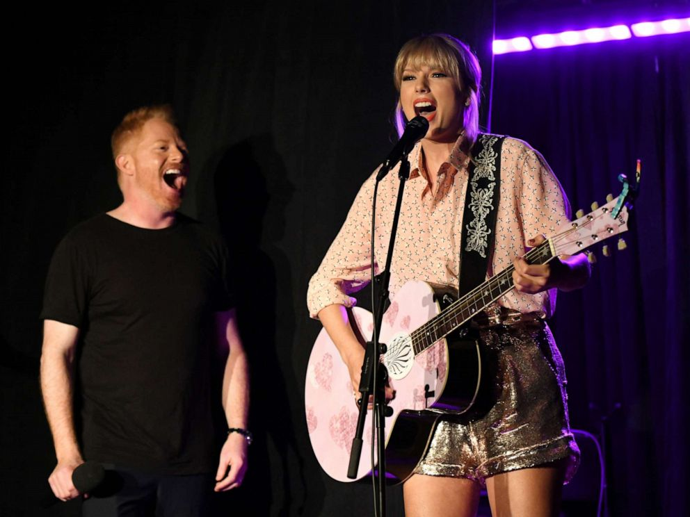 PHOTO: Jesse Tyler Ferguson (L) and Taylor Swift perform at AEG and Stonewall Inns pride celebration commemorating the 50th anniversary of the Stonewall Uprising.
