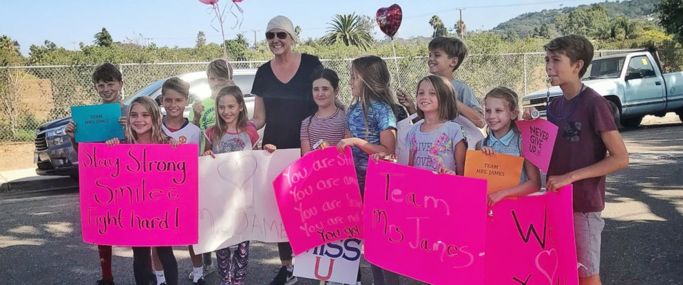 PHOTO: Katherine James was surprised by a mob of students at her home on the last day she underwent chemotherapy.