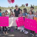 Katherine James was surprised by a mob of students at her home on the last day she underwent chemotherapy.