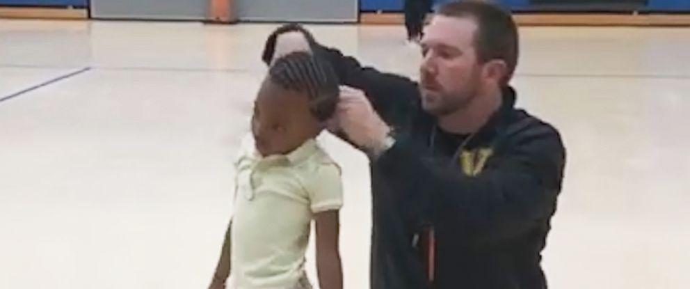 PHOTO: P.E. teacher Jonathan Oliver was filmed while putting Kristen Paulks hair in a ponytail at WG Nunn Elementary School in Valdosta, Ga.