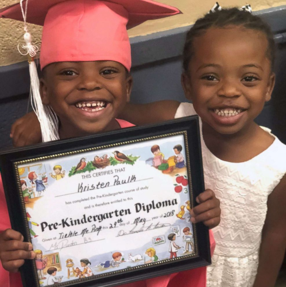 PHOTO: Kindergartner Kristen Paulk, left, is photographed with her sister, Claire Cleckly in an undated family photo. Kristen appeared in a viral video while her teacher Jonathan Oliver put her hair in a ponytail during gym class.