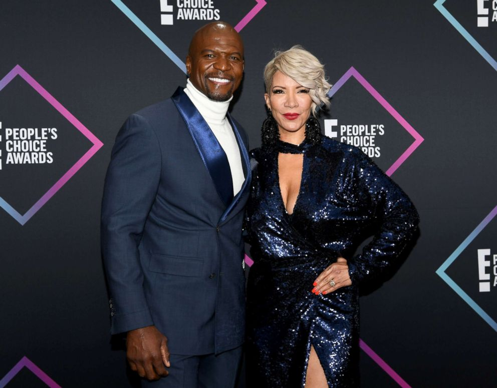 PHOTO: Terry Crews and Rebecca King-Crews arrive to the 2018 E! Peoples Choice Awards held at the Barker Hangar, Nov. 11, 2018.