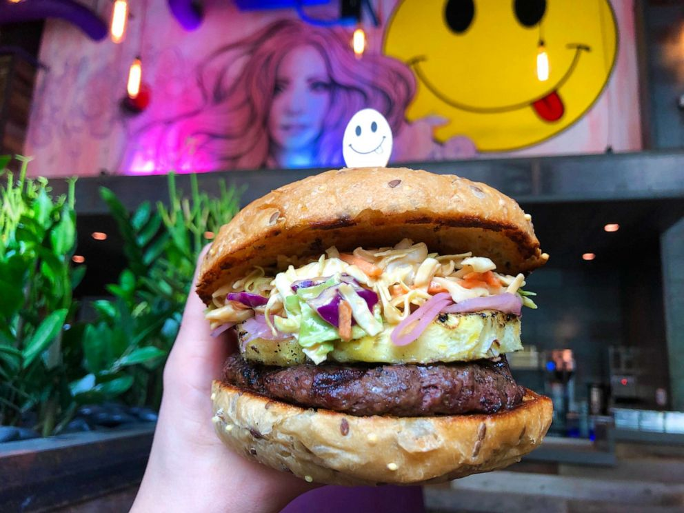 PHOTO: The Thai Knee Dancer burger at SkinnyFATS in Dallas, Texas includes a grass-fed quarter-pound patty, pickled red onion, grilled pineapple and cabbage peanut slaw inside a whole wheat bun.