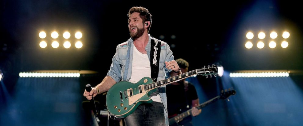 PHOTO: Thomas Rhett performs onstage during the 2018 CMA Music festival at Nissan Stadium on June 10, 2018 in Nashville.