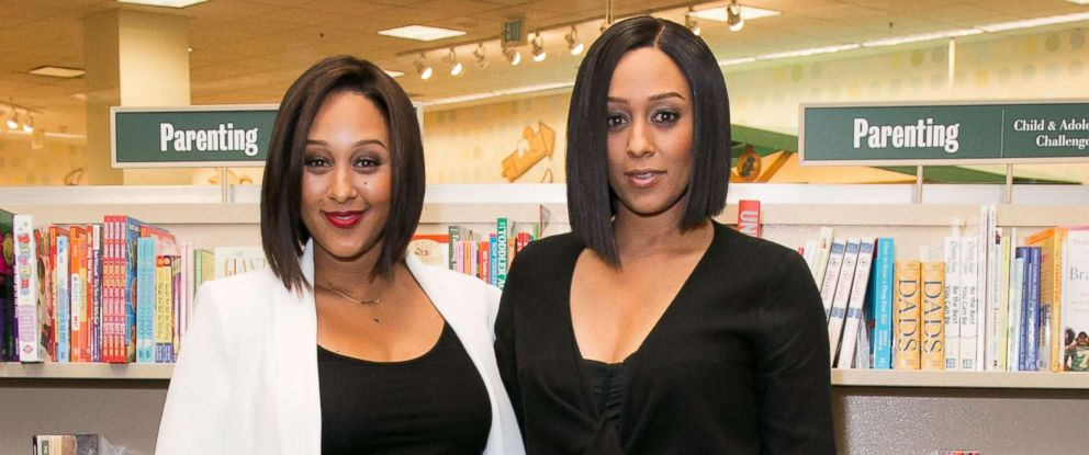 "PHOTO: Tamera Mowry (L) and Tia Mowry sign and discuss their new book ""Twintuition"" at Barnes & Noble bookstore at The Grove, April 21, 2015, in Los Angeles."