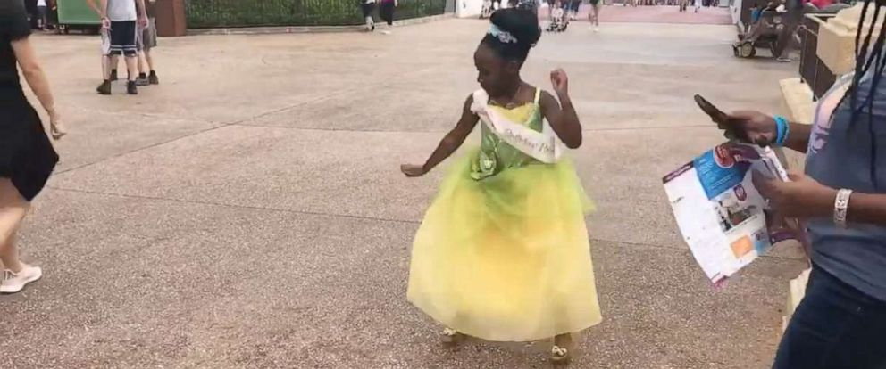 PHOTO: 8-year-old Sydney Elise Russell dances at Walt Disney World dressed as Princess Tiana.