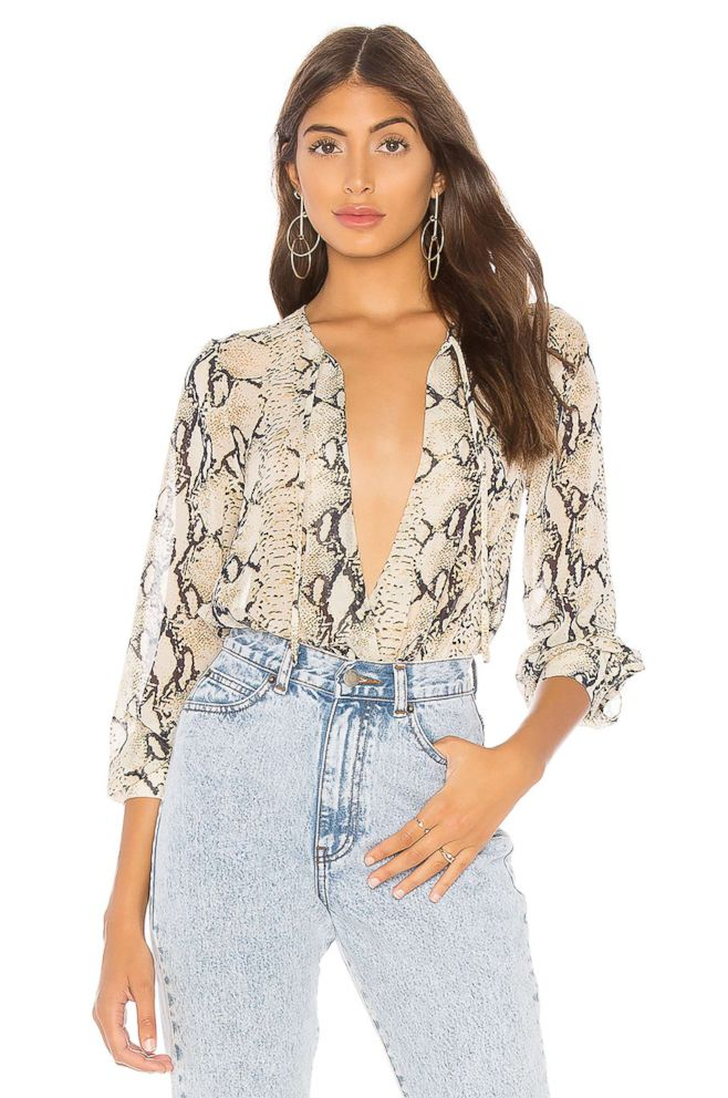PHOTO: Style Hint: If you havent tried a bodysuit blouse, this lightweight one in a snakeskin might inspire you. We love it because it creates the perfect tucked-in look without having to bother with extra fabric in your skinniest jeans.