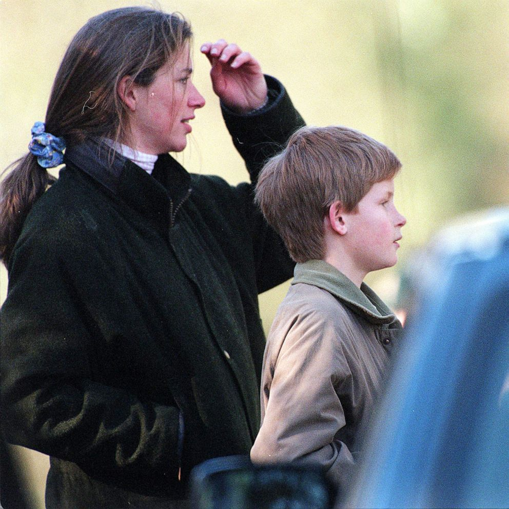 PHOTO: Prince Harry and Tiggy Legge-Bourke watch Charles, Prince of Wales, take part in the Beaufort Hunt in March 1997 in Malmesbury, England.