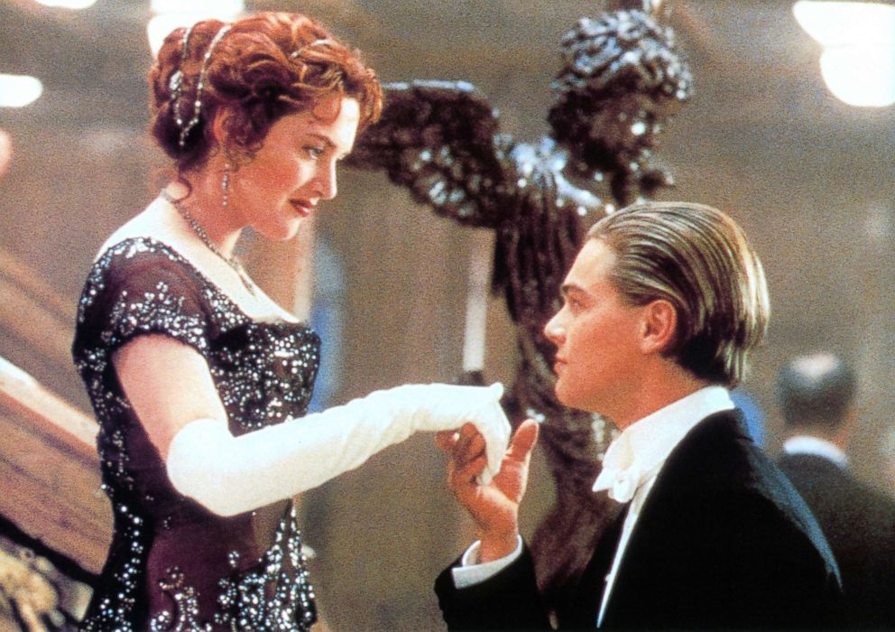 PHOTO: Kate Winslet offers her hand to Leonardo DiCaprio in a scene from the film Titanic, 1997.
