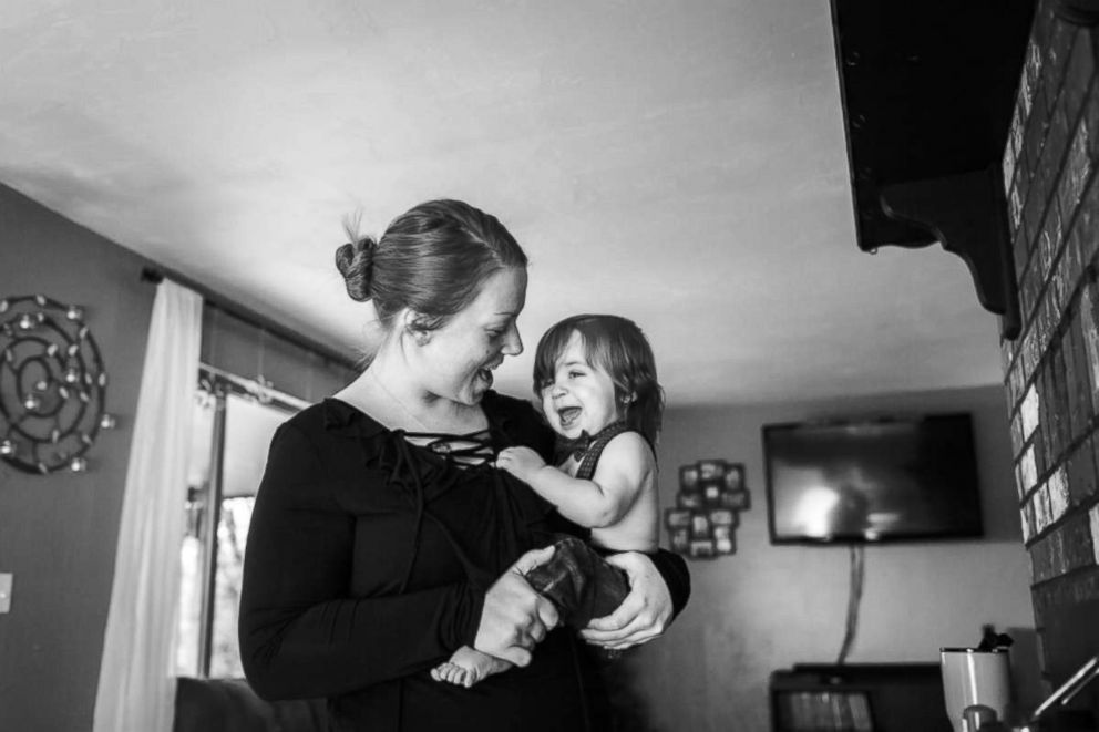 PHOTO: Rena Sickles of Toledo, Wash., holds her 1-year-old son Titus, a heart transplant survivor.