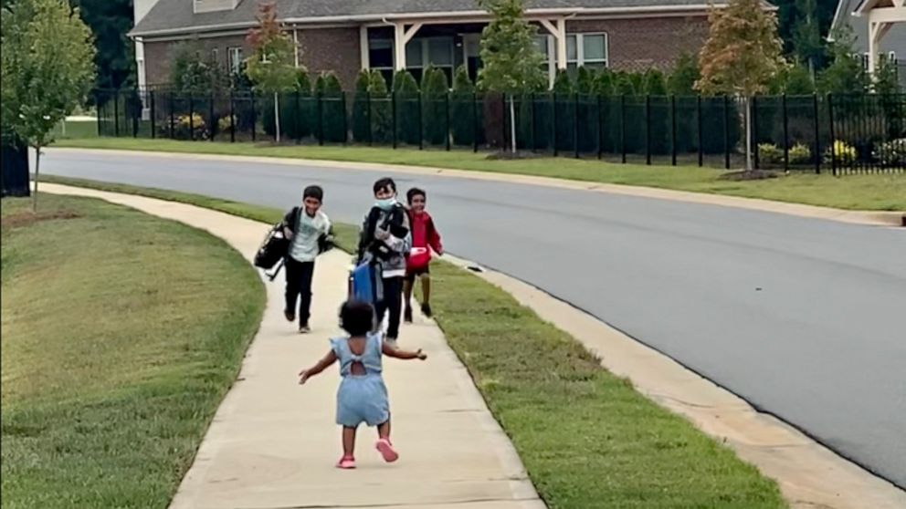 Toddler greeting her brothers after school gets viral love   GMA