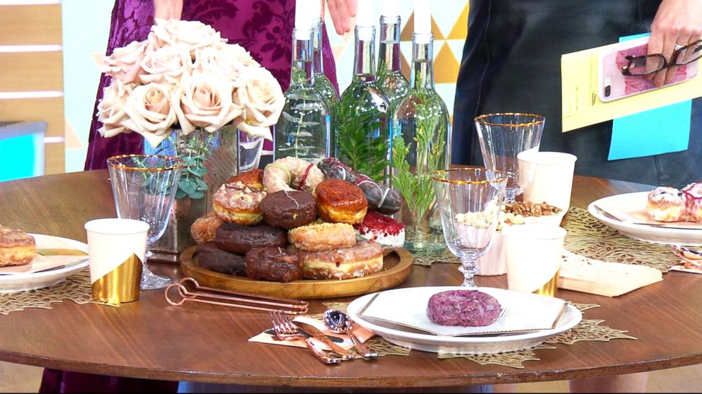 Doughnuts and rose gold and blush decorations are hot New Year's Eve party trends in 2018.
