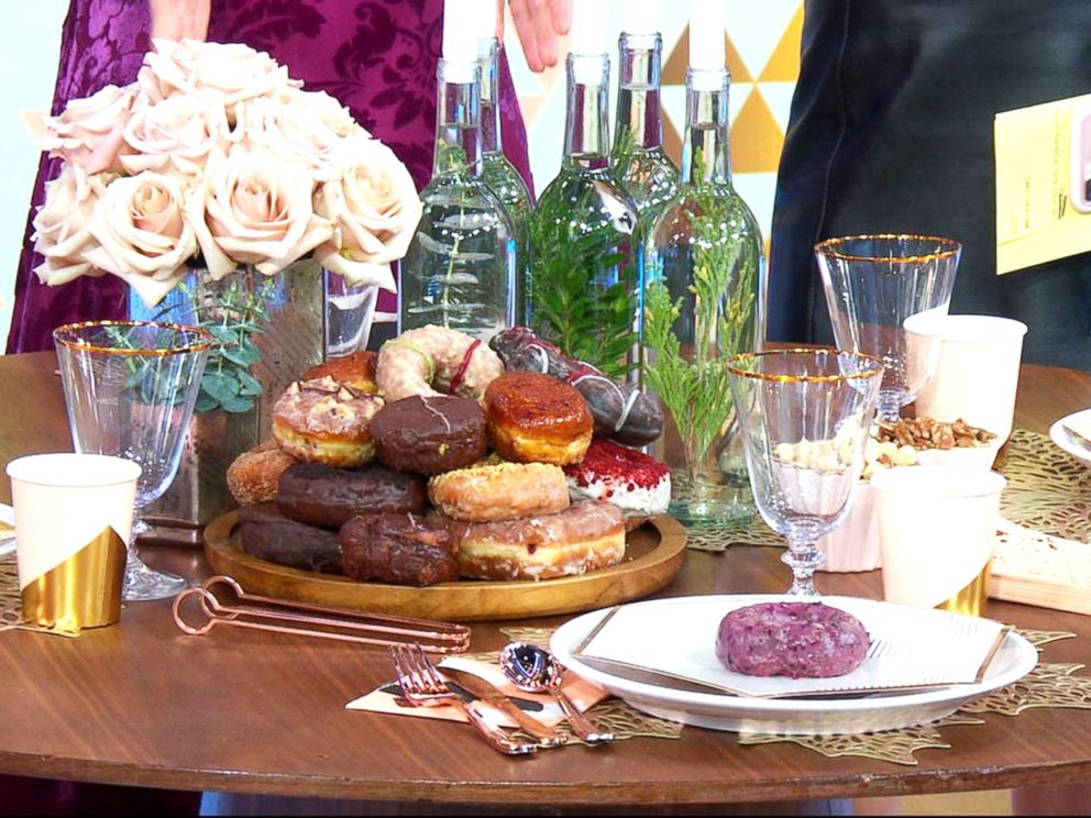 photo doughnuts and rose gold and blush decorations are hot new years eve party trends