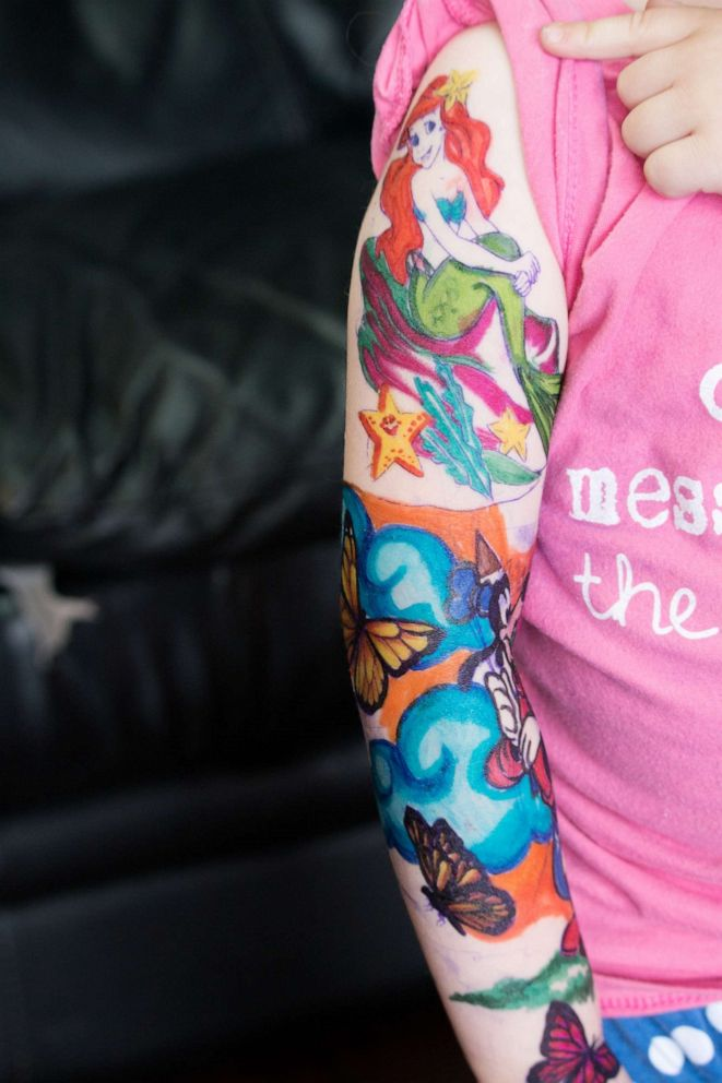 PHOTO: Trinity DAutorio, 3, received temporary tattoos at Ink Wolves tatooo shop in Tampa, Fla, April 10.