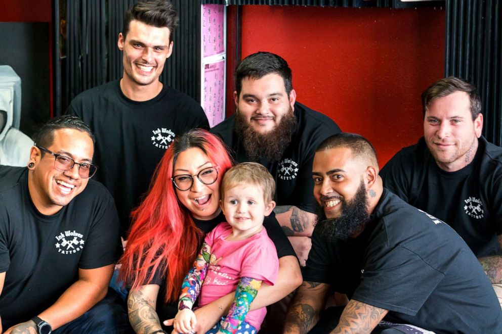 PHOTO: Trinity DAutorio, 3, is seen in a recent photo with the staff at Ink Wolves tatooo shop in Tampa, Fla.