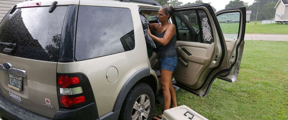 PHOTO: Amy Vasquez packs her car with belongings as Tropical Storm Barry approaches land in Port Sulphur, La., July 11, 2019.