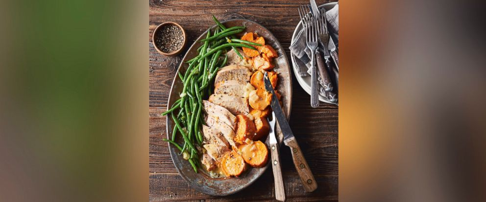"""PHOTO: Turkey breast with sweet potatoes, green beans and gravy are pictured from the cookbook """"Skinnytaste One & Done"""" by Gina Homolka."""