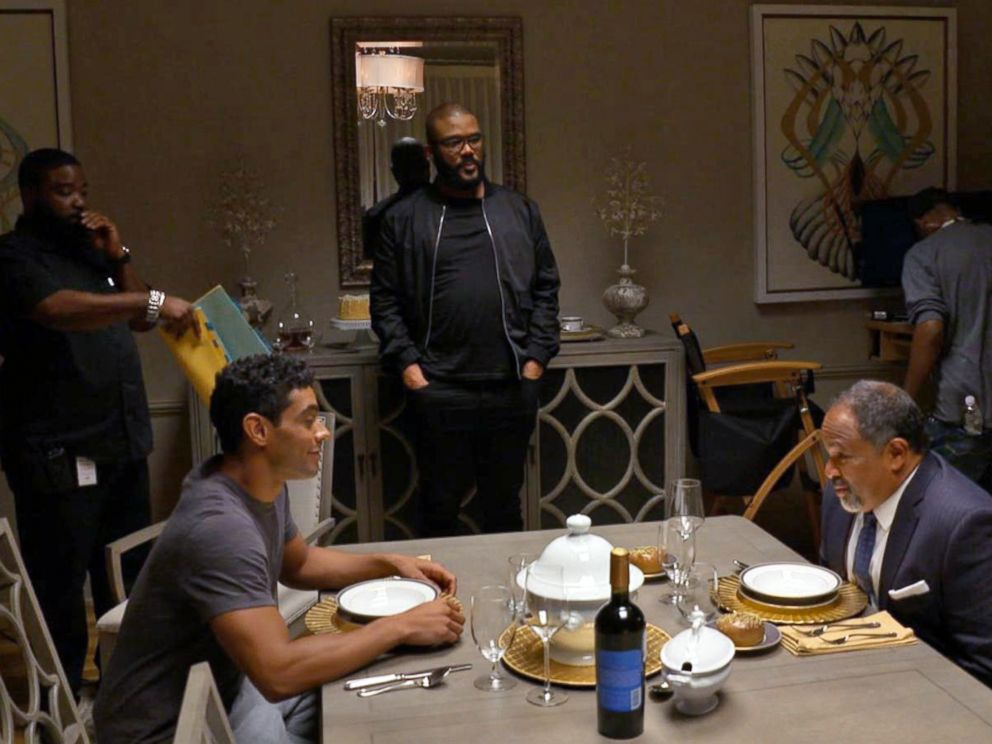 PHOTO: Tyler Perry watches a scene starring Geoffrey Owens in The Haves and the Have Nots.