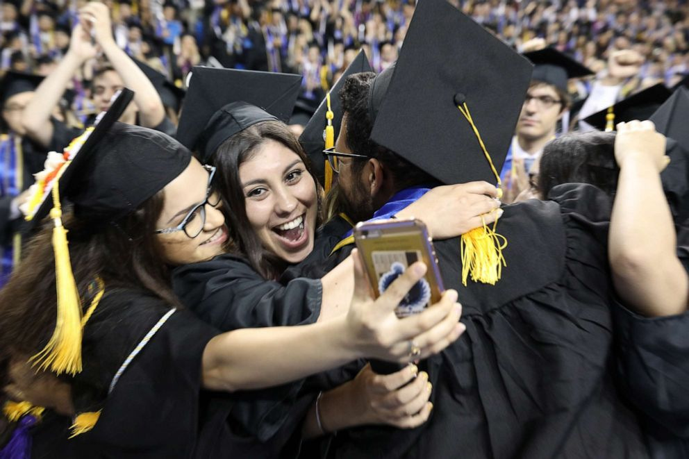 PHOTO: New graduates celebrate at the UCLA College of Letters and Science Commencement Ceremony on June 14, 2019, in Los Angeles.
