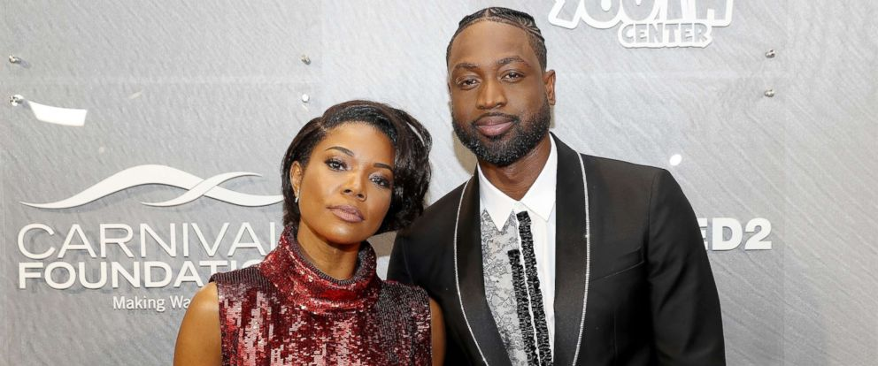 """PHOTO: Gabrielle Union and Dwyane Wade attend the 6th annual """"A Night On The Runwade"""" at Aventura Mall, March 16, 2019, in Miami, Florida."""