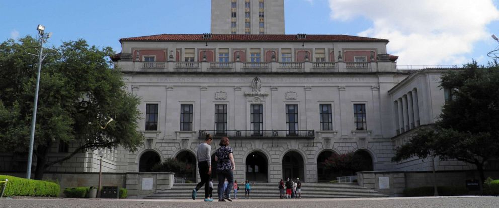 PHOTO: In this file photo, people walk at the University of Texas campus in Austin, Texas, on June 23, 2016.