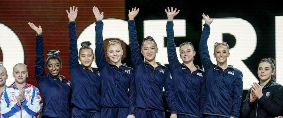 PHOTO: The winning US team celebrate with their gold medals on the podium after the womens team final at the FIG Artistic Gymnastics World Championships at the Hanns-Martin-Schleyer-Halle in Stuttgart, Germany, Oct. 8, 2019.