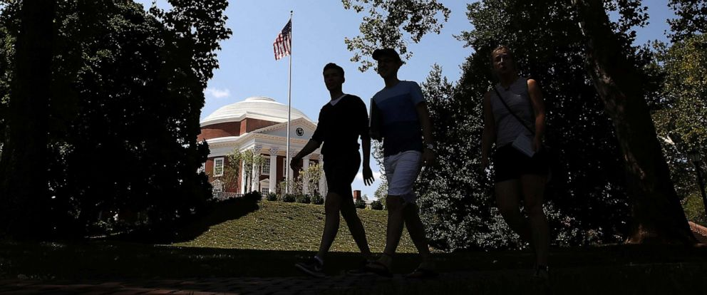 PHOTO: Students cross the campus at the University of Virginia, Aug. 19, 2017 in Charlottesville, Va.