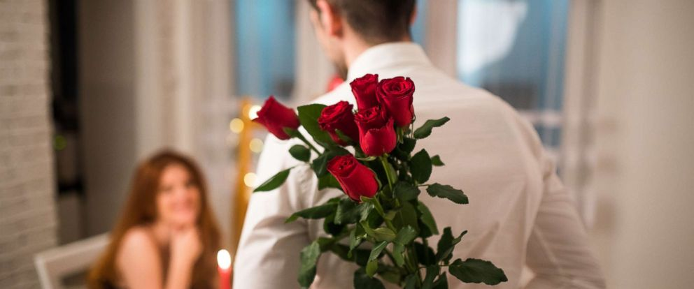 PHOTO: An undated stock photo of a man holding roses.