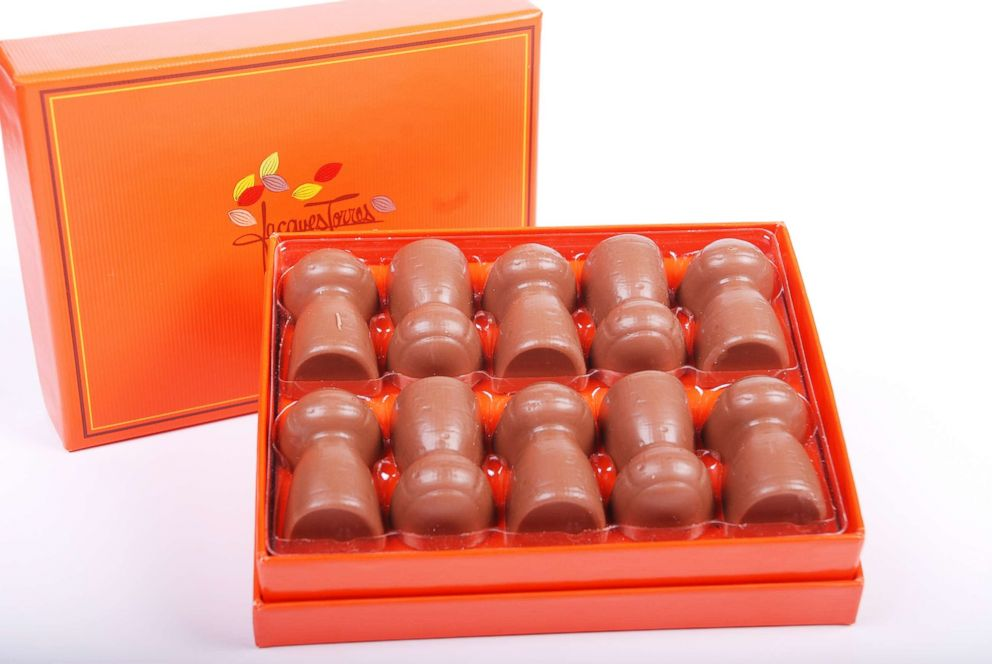 PHOTO: These Jacques Torres truffles combine milk chocolate, fresh cream and real Taittinger Brut La Francaise Champagne.