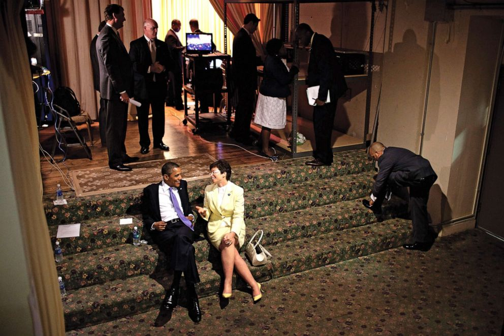 PHOTO: Valerie Jarrett kicks back on the stairs with President Obama before an event.