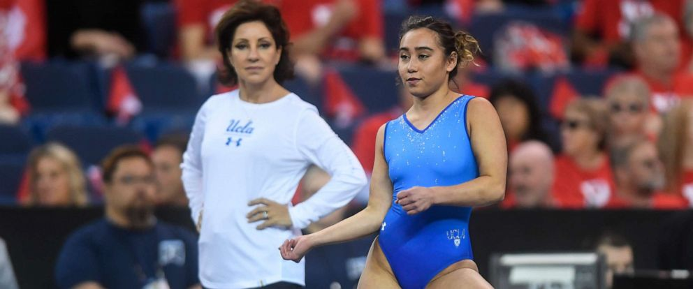 PHOTO: Head Coach Valorie Kondos Field watches over Katelyn Ohashi from UCLA as she practices on the floor exercise during the warm ups before the first preliminary session held at the Fort Worth Convention Center in Fort Worth, Texas, April 19, 2019.