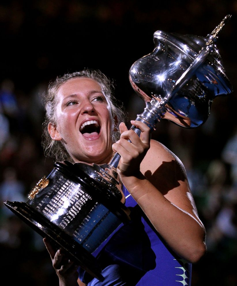 PHOTO: Victoria Azarenka of Belarus poses with the Daphne Akhurst Memorial Cup after winning her womens final match at the 2012 Australian Open at Melbourne Park on Jan. 28, 2012 in Melbourne, Australia.