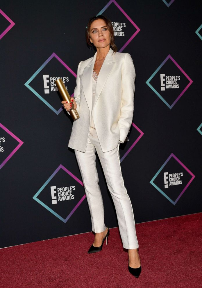 Victoria Beckham, recipient of the 2018 Fashion Icon Award, poses in the press room during the People's Choice Awards 2018 at Barker Hangar, Nov. 11, 2018, in Santa Monica, Calif .