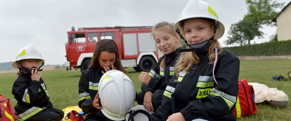 PHOTO: Girls run through a training exercise with the volunteer fire department in the town of Miejsce Odrzanskie, Poland, July 31, 2019. The small Polish town near the Czech border hasnt seen any boys born for over a decade.