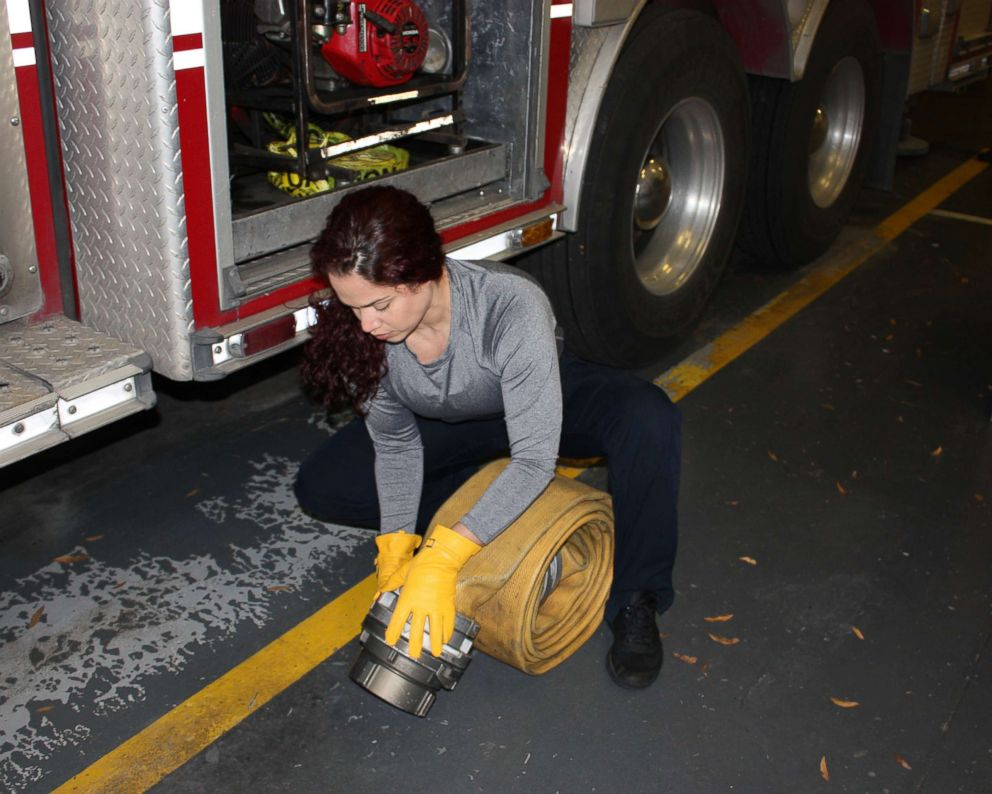 Firefighter paramedic Vivi Rodriguez wearing SeeHerWork gloves while working in the field.