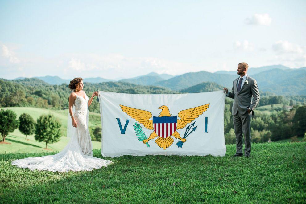 Newlyweds Marty Bruckner and Lauren Saia pose with a U.S Virgin Islands flag.