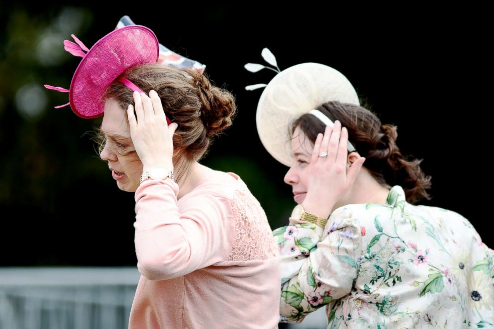 PHOTO: The wind blows as women try to keep their hats on their heads ahead of the Royal wedding of Princess Eugenie of York and Mr. Jack Brooksbank at St. Georges Chapel, Oct. 12, 2018, in Windsor, England.