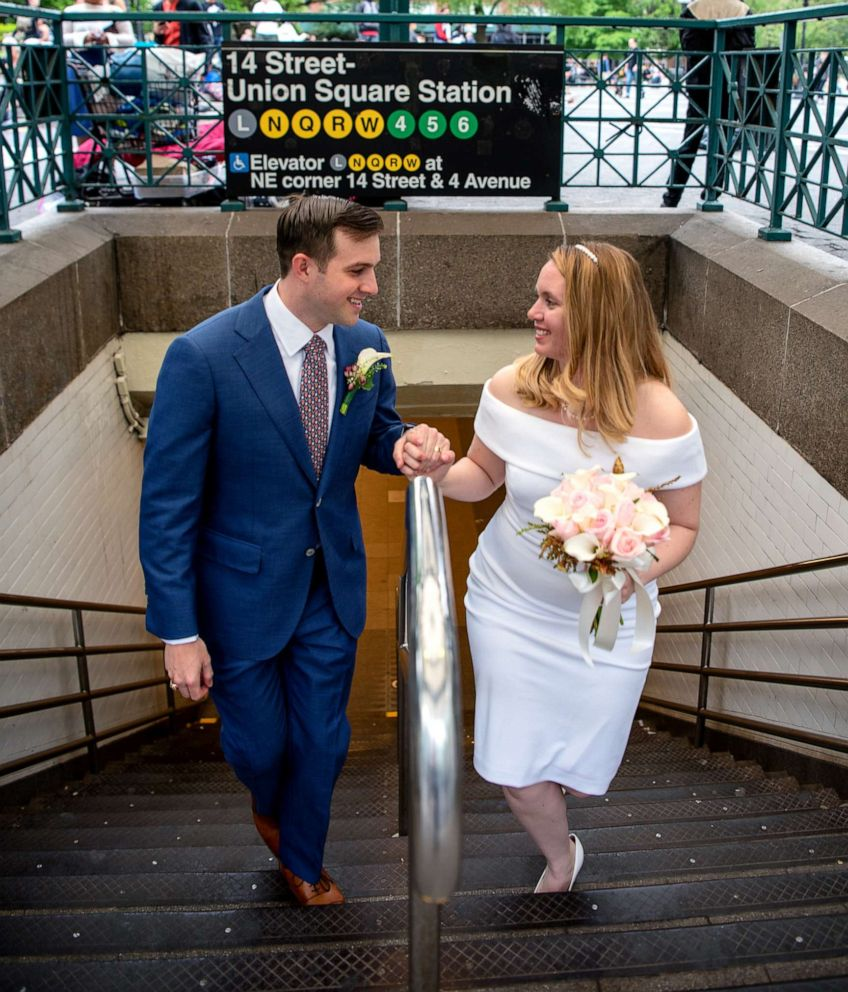 PHOTO: Newlyweds Robert Musso and Frances Denmark exit the subway in New York City following their ceremony.