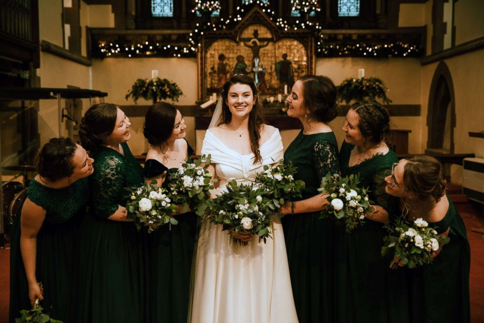 PHOTO: Evelyn Paterson, 24, showed off her dress pockets along with her bridesmaids on her December 8th, 2018, wedding day at All Saints Woodford Wells, North East London.