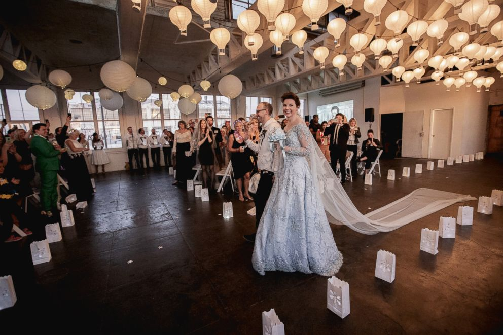 Audrey Moore, an actress living in California, wore a long-sleeve blue, wedding gown as she wed Jesse Lumen on Dec. 30, 2018.
