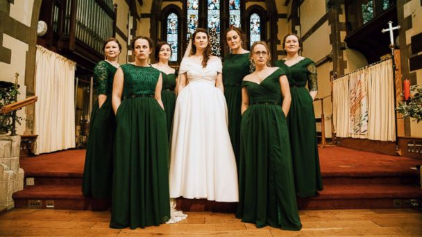 f72283a05 Bridal party s power pose shows off their incredible dresses with ...