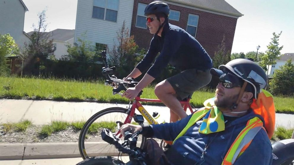 PHOTO: Will Reeve rides alongside Janne Kouri during his two-month journey across the country.