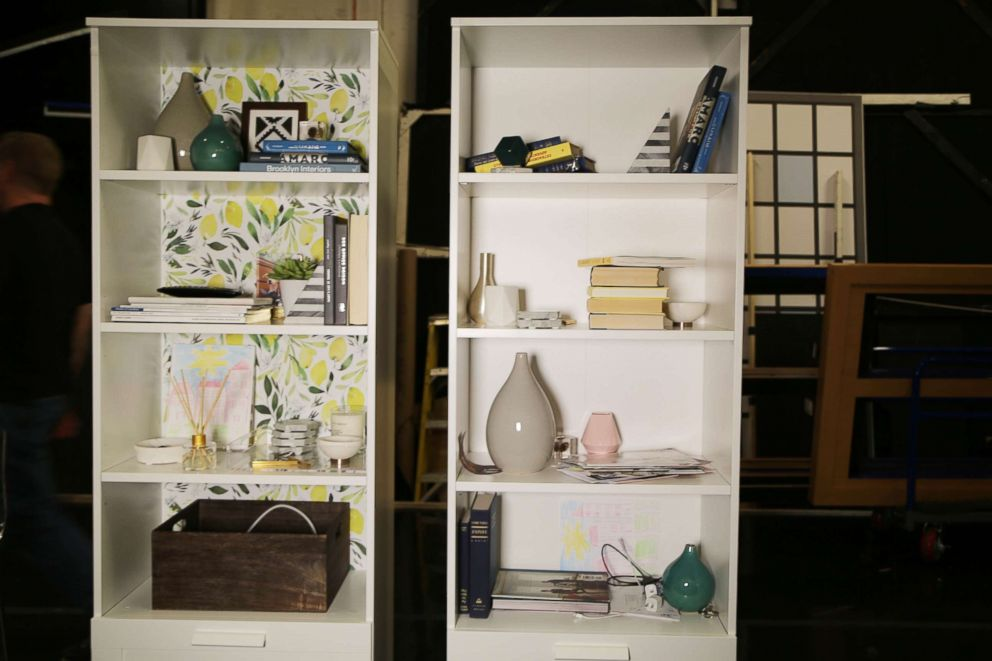 PHOTO: Blogger and designer Will Taylor recommends using wallpaper to brighten bookshelves.