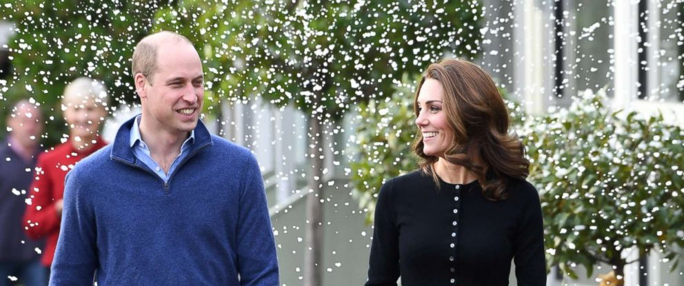 PHOTO: Prince William, Duke of Cambridge and Catherine, Duchess of Cambridge laugh as a machine sprays snow at Kensington Palace, Dec. 4, 2018, in London.